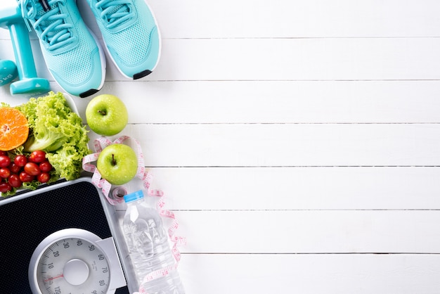 Healthy lifestyle, food and sport concept on white wood Premium Photo
