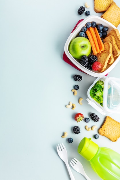 Healthy lunch to go packed in lunch box Free Photo