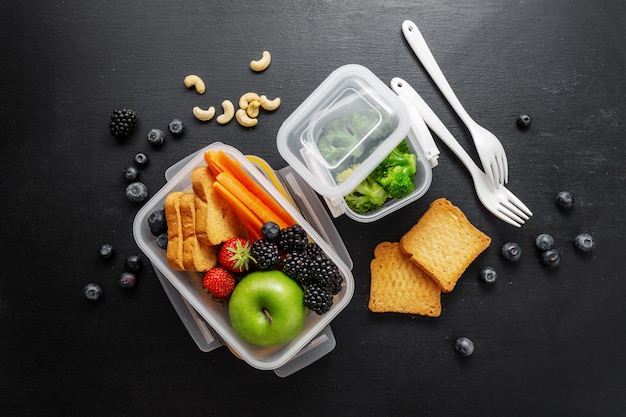 Healthy lunch to go packed in lunch box Premium Photo