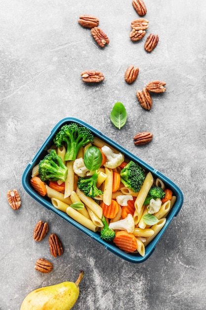 Healthy lunch to go served in box with vegetables Premium Photo