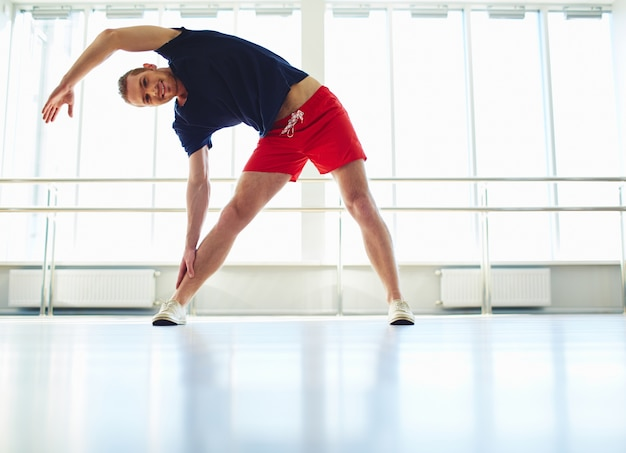 Healthy man stretching Free Photo