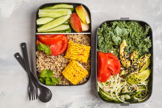 Healthy meal prep containers with quinoa, avocado, corn, zucchini noodles and kale. takeaway food. Premium Photo