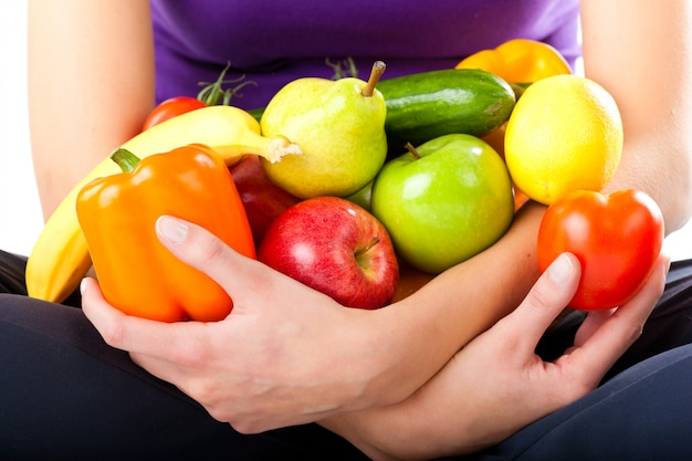 Healthy nutrition - young woman with fruits Premium Photo