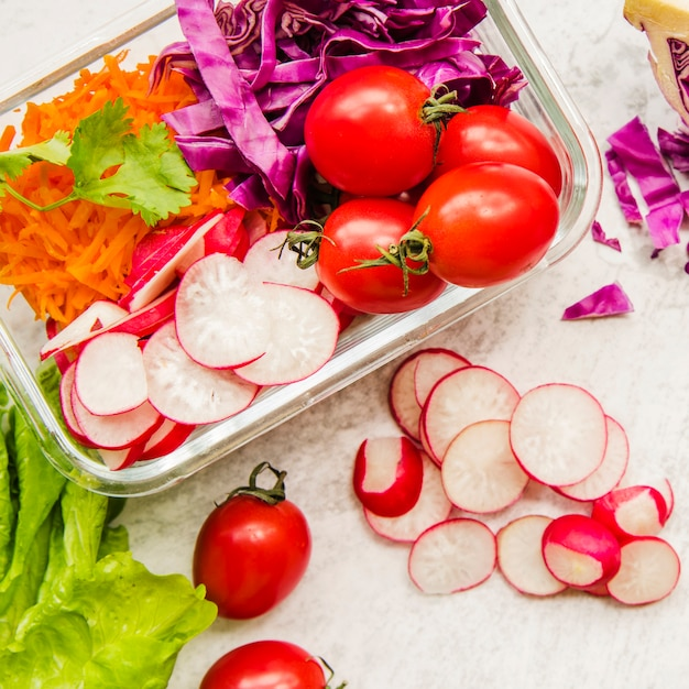Healthy salad ingredients in plastic container Free Photo