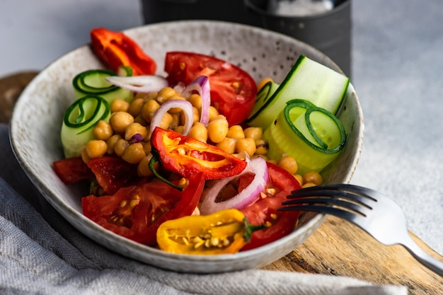 Healthy salad with organic vegetables and chickpea served in a bowl Premium Photo