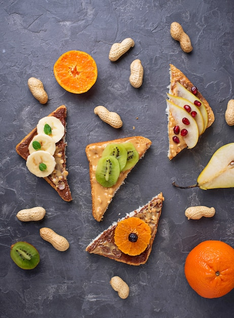 Healthy  sandwiches with peanut butter and fruits Premium Photo