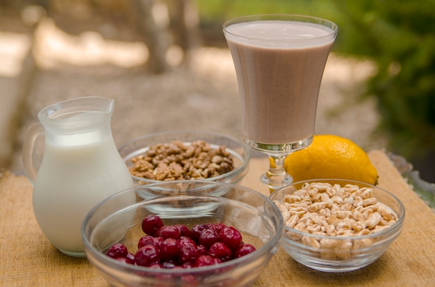 Healthy smoothie with cherry,walnut,expanded rice,lemon,low fat yoghurt or soy milk Premium Photo