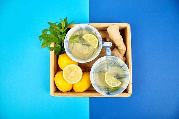 Healthy tea two cups with lemon, ginger, mint Premium Photo