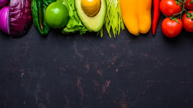 Healthy vegan food concept. fruits vegetables background with copyspace Premium Photo