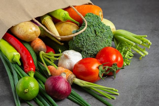 Healthy vegetables on old dark background Free Photo