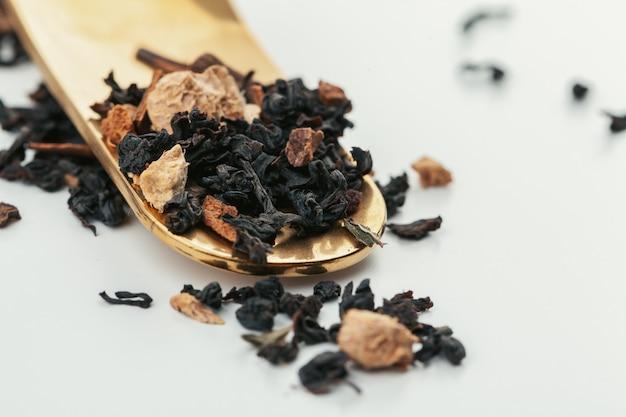 Heap of dried  tea leaves close up Premium Photo