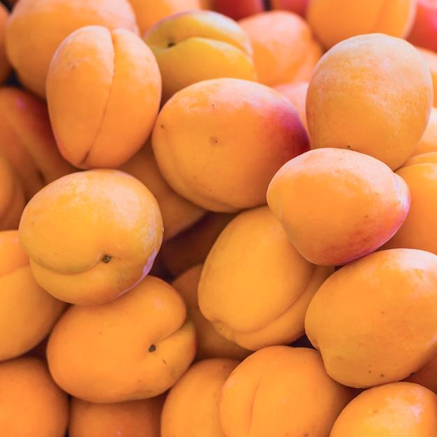 Heap of fresh peaches Free Photo
