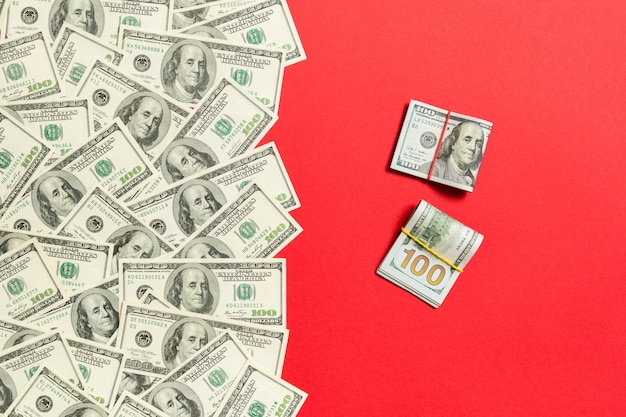 Heap of hundred dollar bills top view, with empty place for your text business money concept Premium Photo