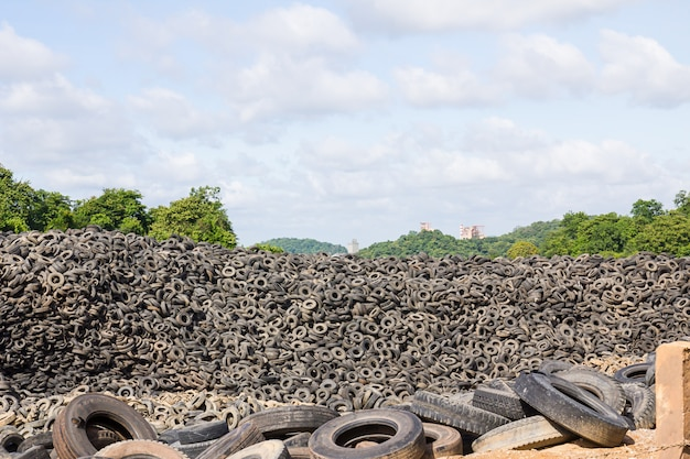 Heap of old tires  in recycling plant in thailand Premium Photo