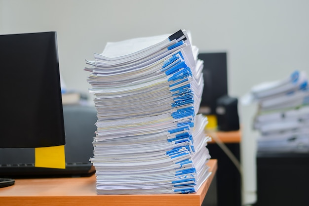 Heap of papers work stack documents on office desk Premium Photo