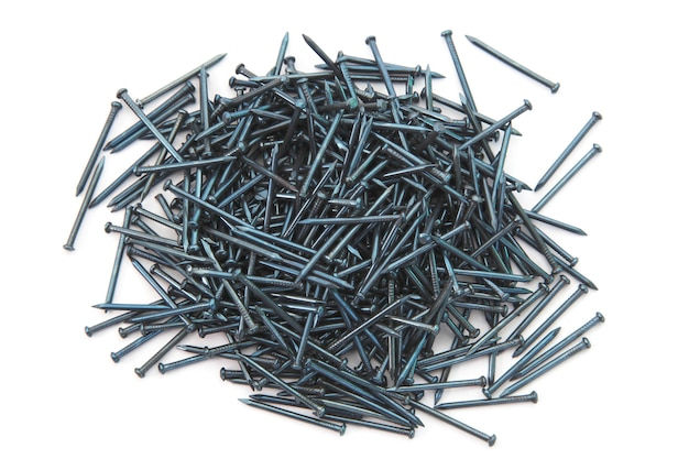 Heap of silver concrete nails isolated on white  Photo