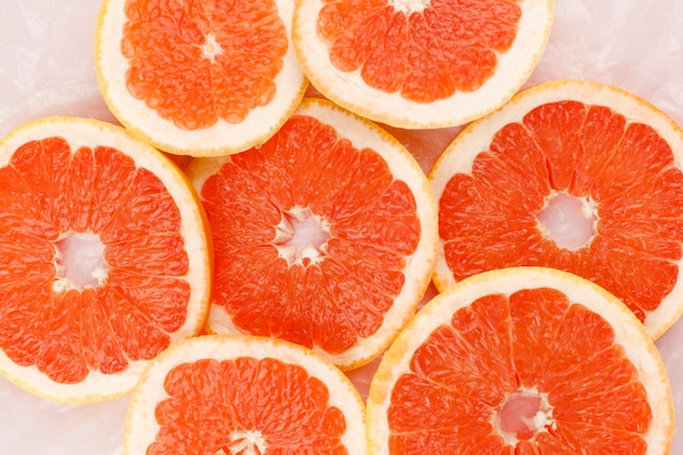 Heap of slices of grapefruit Free Photo