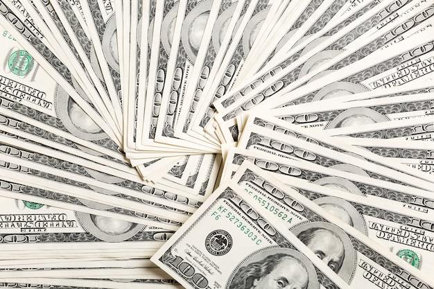Heap of us dollar bills money background Premium Photo