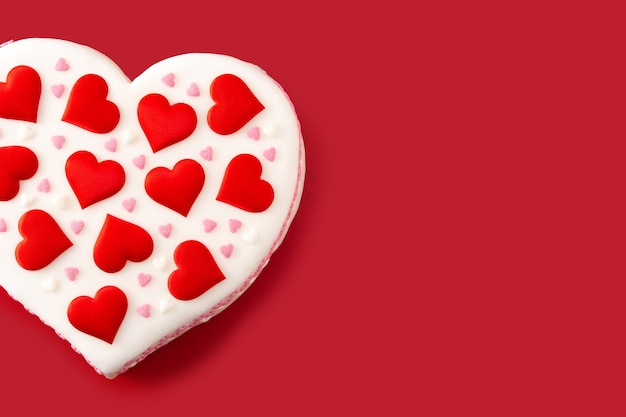 Heart cake for st. valentine's day decorated with sugar hearts Premium Photo