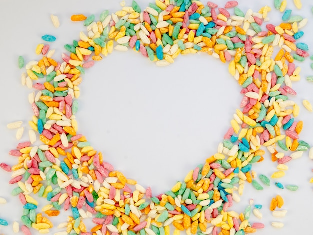 Heart copy space surrounded by candy Free Photo
