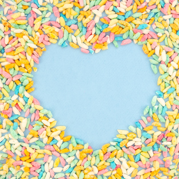 Heart copy space surrounded by sweets Free Photo
