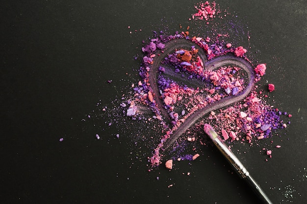 Heart on crushed eyeshadows Free Photo