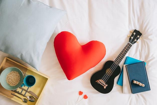 Heart cushion and ukulele Free Photo