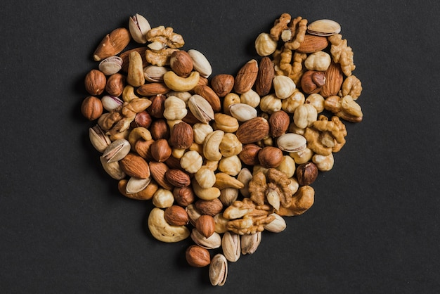 Heart from assorted nuts Premium Photo