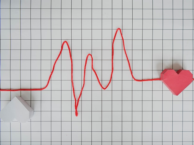Heart line cardiogram paper graph Premium Photo