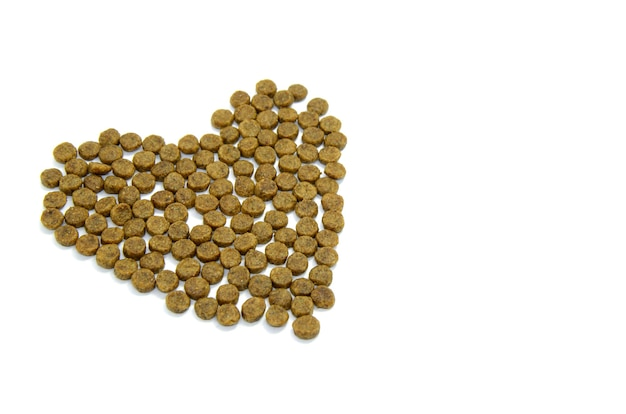 Heart lined with dry animal food isolated on white Premium Photo