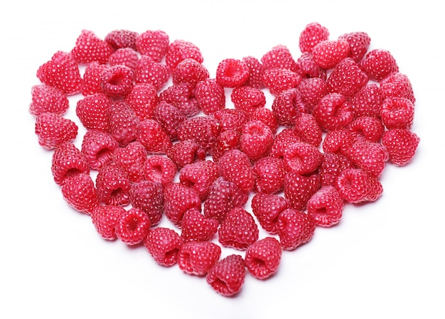 Heart made out of raspberries Free Photo