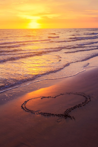 Picture of heart on the beach at sunset