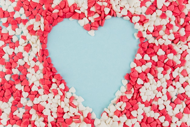 Heart shape formed by colorful candies Free Photo