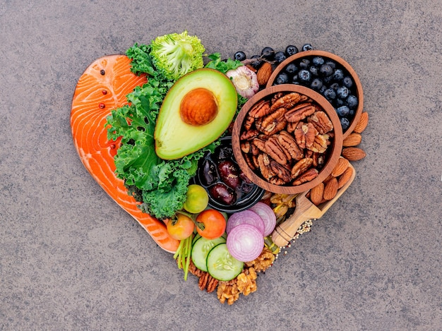 Heart shape of ketogenic low carbs diet concept on dark stone background. Premium Photo