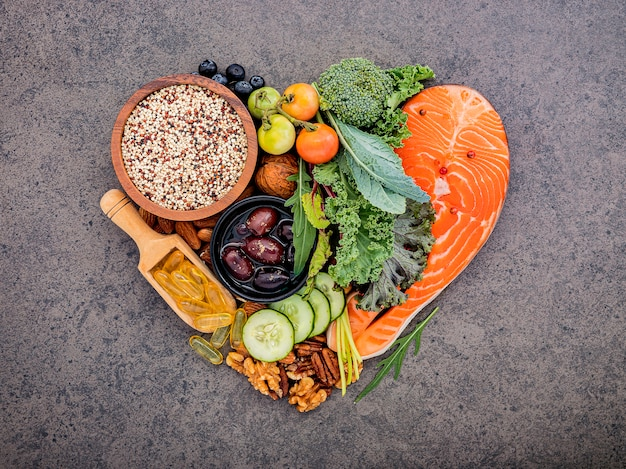 Heart shape of ketogenic low carbs diet concept on dark stone Premium Photo
