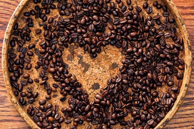 Heart shape made from coffee beans Free Photo