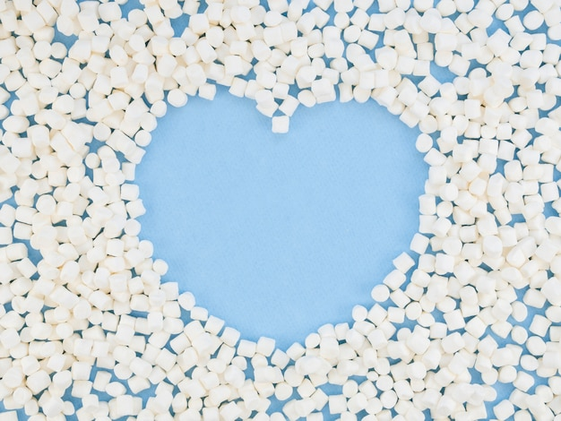 Heart shape surrounded by sweets Free Photo