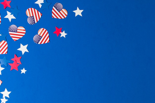 Heart shape usa flags and stars on blue background Free Photo