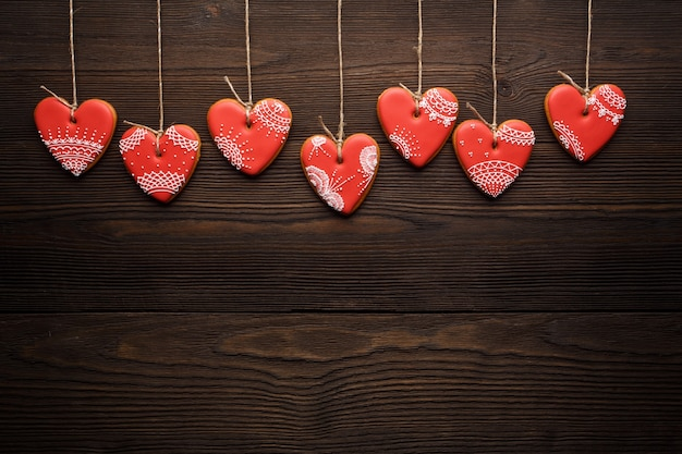 Heart-shaped cookies hanging from ropes Free Photo