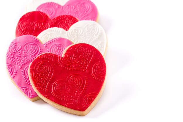 Heart-shaped cookies for valentine's day isolated on white surface. Premium Photo