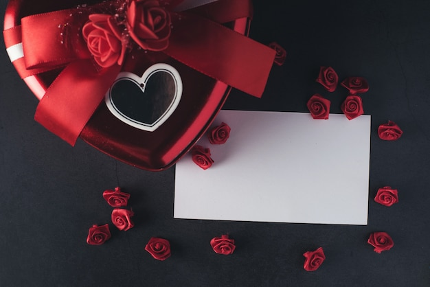 Heart shaped gift box with blank note card, valentines day Free Photo