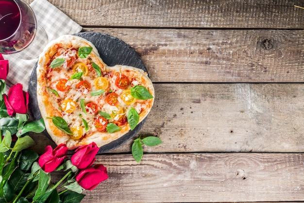 Heart shaped pizza for valentine day Premium Photo
