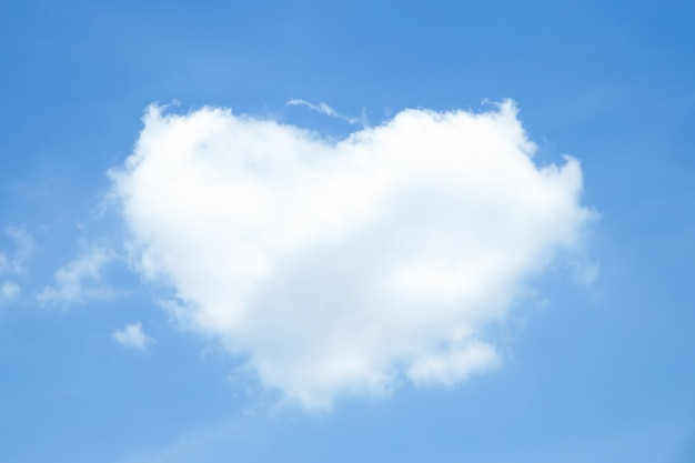 Heart-shaped white clouds on blue sky Premium Photo
