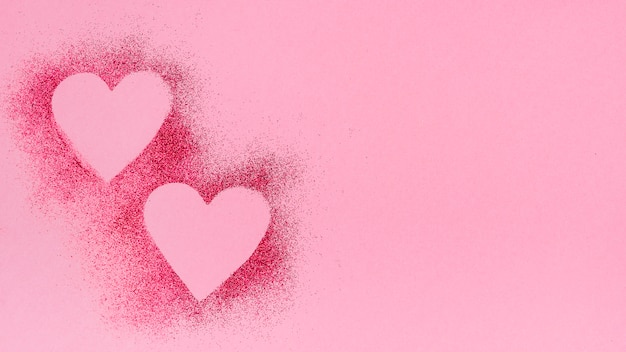 Heart shapes from glitterpowder Free Photo