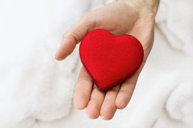 Heart symbol in men hand. Premium Photo