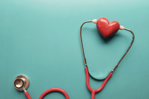 Heart with stethoscope, heart health,  health insurance concept Premium Photo