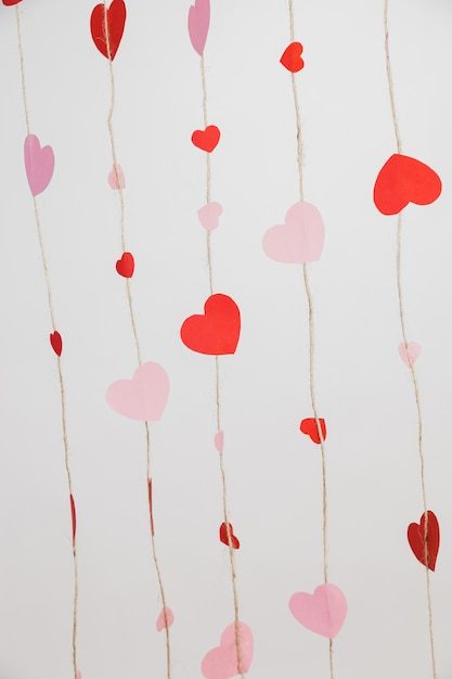 Hearts laid on ropes on a white background Free Photo