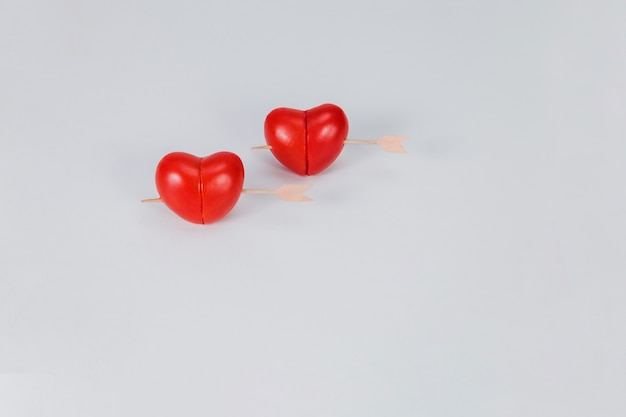 Hearts punctured by a stick Free Photo