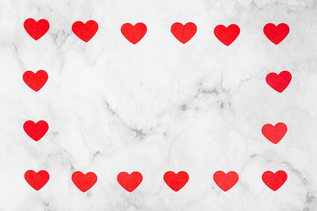 Hearts surrounding marble copy space Free Photo