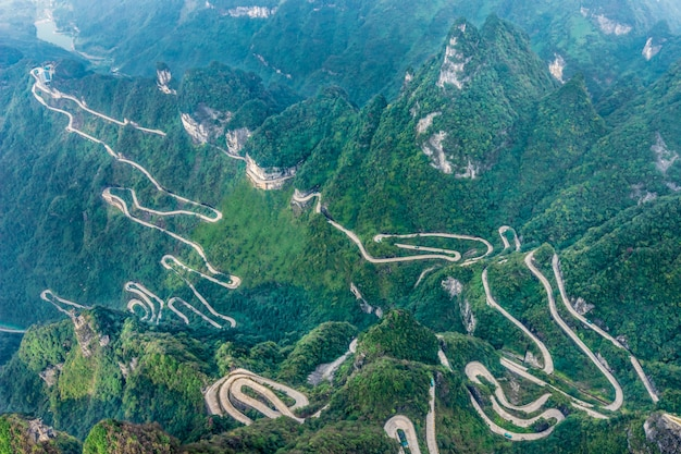 Premium Photo | Heaven linking avenue of 99 curves road to heaven's gate  zhangjiagie tianmen mountain china